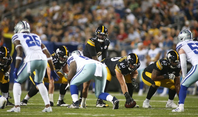 Pittsburgh Steelers quarterback Dwayne Haskins (3) abruptly switches the play during the second half of the 2021 Hall Of Fame Game Thursday night against the Dallas Cowboys at Tom Benson Hall Of Fame Stadium in Canton, Ohio.