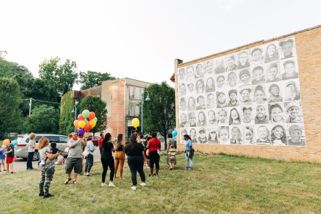 Community members and Aliquippa Impact students celebrated the recent installment of a mural last Tuesday evening. The mural is a part of an international project called the Inside Out project.