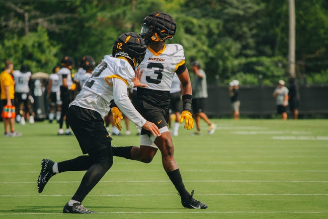Missouri defensive backs Shawn Robinson (12) and Martez Manuel (3) run a drill Aug. 6 at the Kadlec Practice Fields.