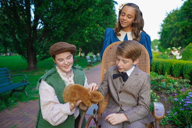 """Left to right: Lizzie Huelskamp as Dickon, Michael Broadhurst as Colin, and (standing) Juliana Chianese as Mary Lennox in the Actors' Theatre of Columbus and Columbus Children's Theatre co-production of """"The Secret Garden."""""""