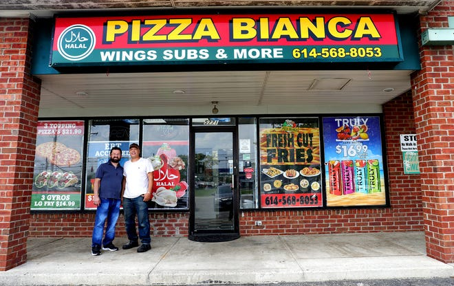 Owners Khalil Abuayyash, left, and Sam Fahim, right, decided a name change was in order, so they swapped out Joy's with Pizza Bianca. Interestingly enough, all the food, including the pizza toppings, such as pepperoni and sausage are halal, meaning they meet Islamic food standards. They also sell a number of freshly made Palestinian dishes, such as hummus, shawarma, falafel and foul madammas, a spread made of fava beans.