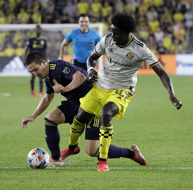 The Crew is seeking more consistency from defender Aboubacar Keita, right.