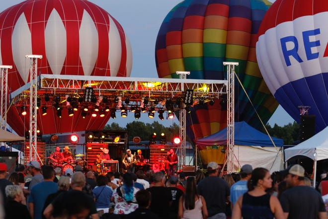 In the evenings, the balloons aglow against the night sky become the backdrop while performers entertain audiences.