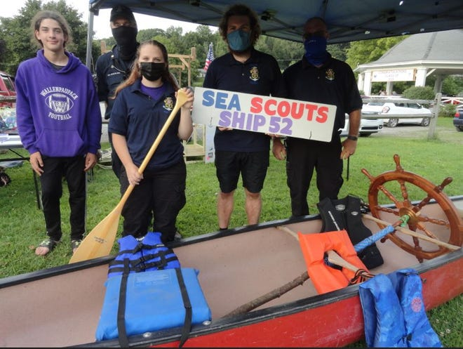 Sea Scouts Ship 52 were represented at National Night Out in Hawley, August 3. People coming up to the tent were taught how to make a square knot. From left are Scout Tyler Worthington; Skid Rollison, their Skipper; Scout Layla Miller; Scout Robbie Opalesky; and the Ship's Mate (and Robbie's father), Rob Opalesky. /Photo by Peter Becker