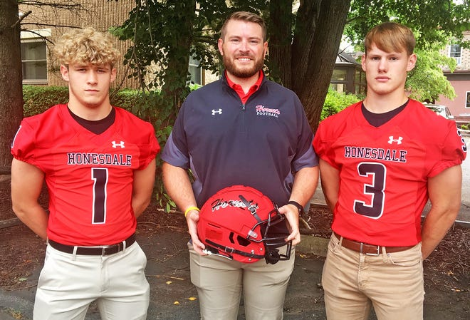 Honesdale was well-represented at the 11th Annual Lackawanna Football Conference Media Day. The event was held Tuesday at the Regal Room in Olyphant and attracted coaches and players from each LFC team. Pictured here with second year skipper Paul Russick are senior tailback Connor Schmitt (3) and junior wideout Tyler Winters (1).