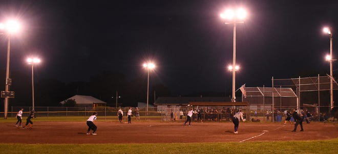 Teams from Waterville and Cooperstown play under the lights at the David P. Whalen Community Park in Ilion Monday. The 10-team Whalen Park High School Fastpitch Softball League for returning varsity players completed its 2021 season with six games Monday and six more Tuesday.