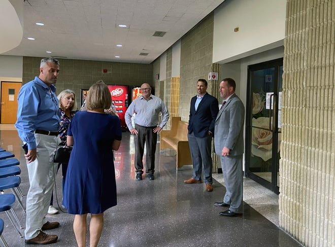 GC DA Brett Smith, on the right by the black framed doors) stands with members of Stephen Obar's family Thursday after jurors convicted Lindsley Cravens of murder in Obar's Aug. 28,2020 shooting death. (Jerrie Whiteley / Herald Democrat).