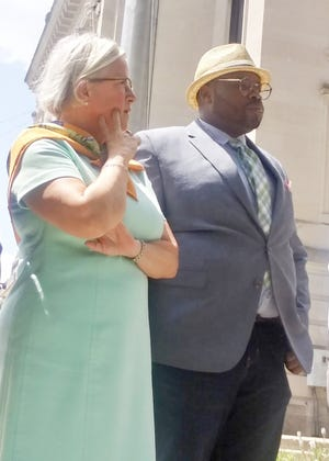 Bloomington attorney Katharine Liell and her client, Vauhxx Booker, hold a news conference in August outside the Monroe County Courthouse. Booker was charged July 30, 2021, in connection with a July 4, 2020, melee at Lake Monroe in which he says he was battered and threatened with racial slurs.