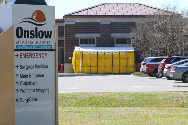 A COVID-19 screening tent was set up outside the emergency room at Onslow Memorial Hospital, March 2020.