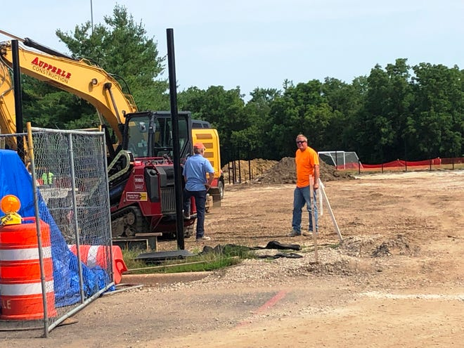 Construction under way in early July on Richwoods High School tennis courts.