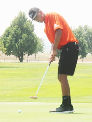 La Junta High School's Donovan Roman putts on the ninth green at the La Junta Invitational Friday at the La Junta Municipal Golf Course. Roman finished second with 27 points under Stableford scoring rules and the Tigers finished second as a team.