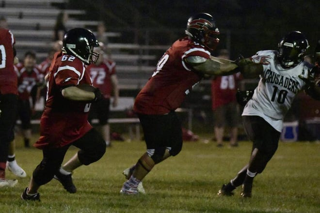 Jesse Gerweck takes off on his 82-yard touchdown run for the Southeast Michigan Red Storm.