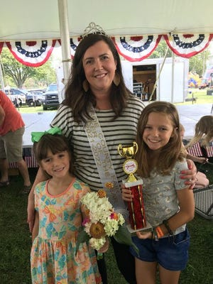 Kristin Anikewich, the newly crowned 2021 Monroe County Homemaker of the Year, stands with her daughters, Chloe and Isabel. She and her husband, Ronald, also have a son, Jacob.