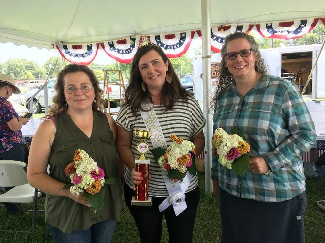 Stacey Westbrook (left) was second-runner up for the homemaker title. Charity Ickes (right) was first-runner up. Kristin Anikewich (center) won the homemaker award. Monroe News photo by Suzanne Nolan Wisler