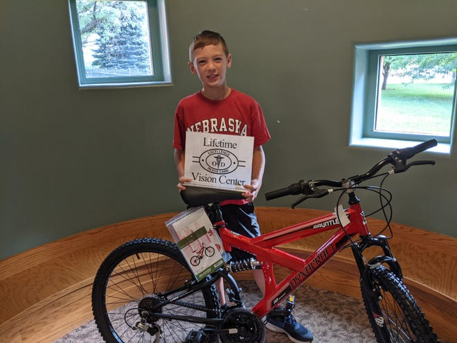 Titus Baltensperger was the winner of the end-of-summer drawing for a 24-inch, 18-speed Dynacraft Gauntlet mountain bike at the Morton-James Public Library. Titus was one of 37 summer reading program participants who entered the drawing for the bike, which was provided to the  library by Lifetime Vision Center.