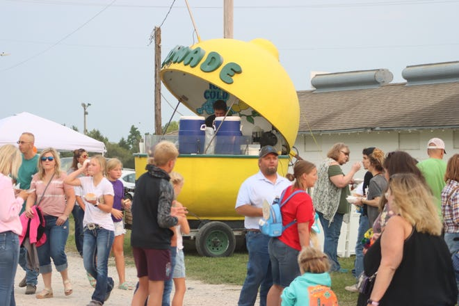 Vendors of all shapes and sizes served crowds of hungry, thirsty and purchase-minded patrons outside the entry gate to the 2021 Sidney Iowa Rodeo. Included in the offerings was lemonade served from a lemon-shaped store front.