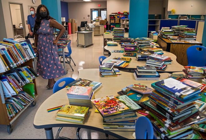 Standing in a Media Center full of books to be put away, Principal Vernicka Murray talks about the rebuilt Washington Elementary School Thursday, Aug. 5, 2021. The replacement school (the original was built in 1963) will welcome students next week. It was one of two schools replaced and opening this fall. The other is Addison Mizner in Boca Raton.