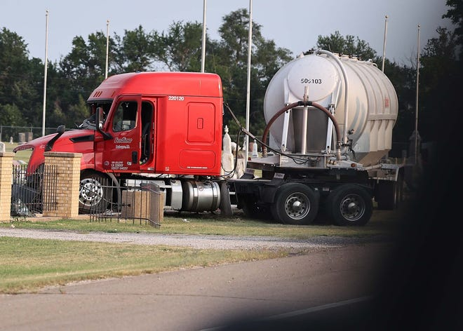 A semi truck and trailer sits in the Fairview Cemetery after it drifted off of U. S. Highway 281 on Thursday near St. John and crashed into a cemetery.