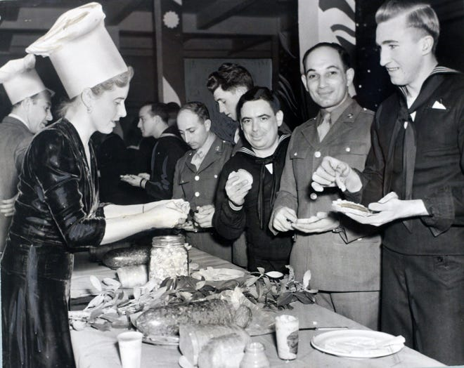 In December 1942, servicemen enjoyed themselves at the Gallery Canteen in Providence. Mrs. Gordon Washburn, wife of the director of the Rhode Island School of Design Museum, was among the volunteers serving refreshments.
