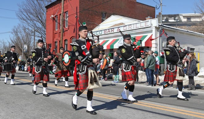 The Rhode Island Pipes and Drums, made up of firefighters, marches down Smith Street in the Providence St. Patrick's Day parade in 2019. The parade, postponed due to COVID-19, is planned for September 18.