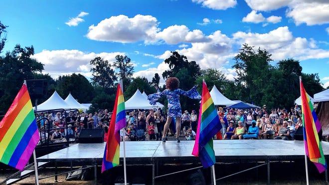 """""""Dive Daphne"""" (Bill Sullivan) on stage during Eugene Pride 2019 in Alton Baker Park."""