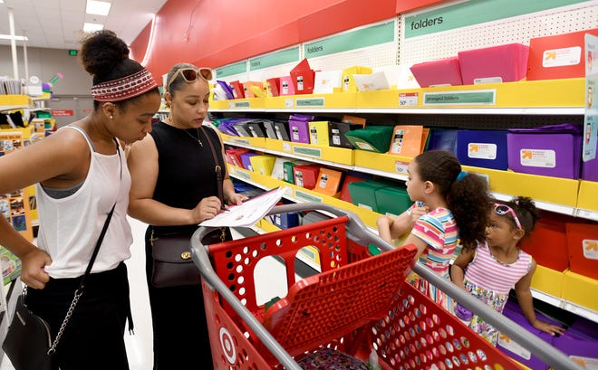 Chimere Hodoh, of Green, shops for school supplies with her kids at Target in Belden Village during Ohio's annual sales tax holiday.