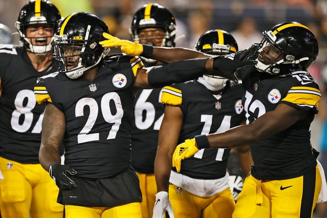 Steelers running back Kalen Ballage (29) celebrates with wide receiver James Washington (13) after Ballage scored a 4-yard touchdown during the second half against the Cowboys in the Pro Football Hall of Fame Game, Thursday, Aug. 5, 2021, in Canton. (AP Photo/Ron Schwane)