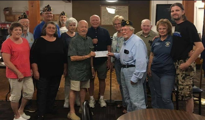 American Legion Post 230 , Auxiliary and Sons held a bingo July 24 to assist the Martinsville Senior Center and donated $2,000 to the organization.  Featured are members of the Senior Center with the members who helped with the bingo: Commander - Roger Coffin,  Phil Deckard,  Randy Sichting,  John McGee,  Chester Jandreau,  Josh Scully and Sherri McGee.