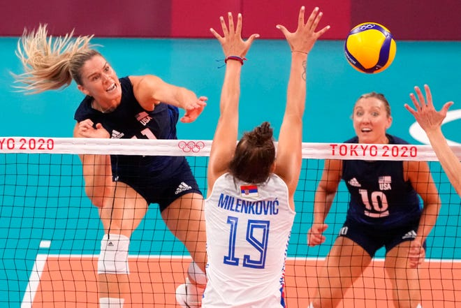 USA's Annie Drews (11)  spikes against Serbia during the Tokyo 2020 Olympic Summer Games at Ariake Arena. Drews, an Elkhart native, and her teammates won to advance to the gold medal game.