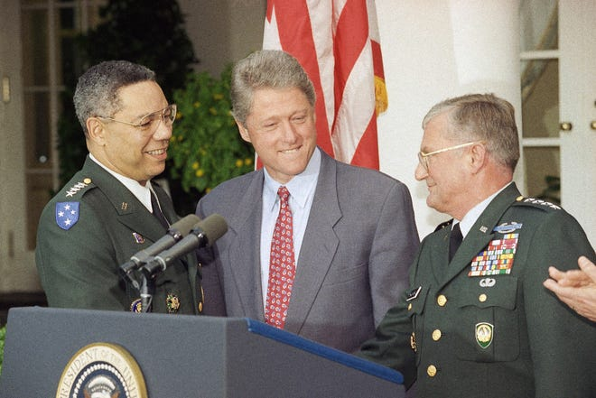 Chairman of the Joint Chiefs Gen. Colin Powell, left, congratulates his replacement, Army Gen. John Shalikashvili, as President Bill Clinton looks on during a White House ceremony on Aug. 11, 1993 to announce the succession. Powell retired that September. Shalikashvili is a former resident of Peoria, Illinois, where he attended Peoria High School and Bradley University.