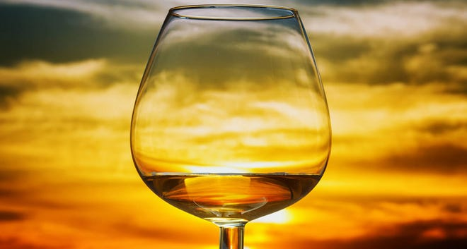 Glass of brandy at sunset