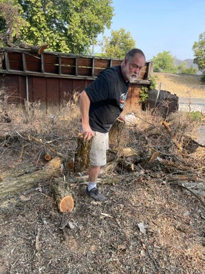 Yreka City Council member Paul McCoy during clean-up work on the permeant homeless urban camp site in Yreka on Saturday,  July 24.