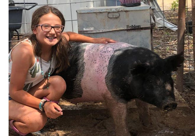 Kendra Carlson and her pig Dwayne.