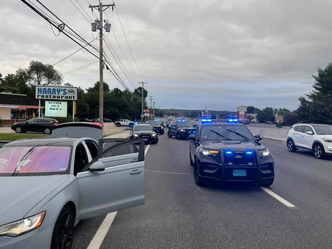 The driver of the car at left was allegedly involved in a road rage incident in Boston. The vehicle was spotted by a Southboro police officer and pulled over in Westboro.