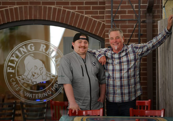 Myles Barber, the new executive chef at Flying Rhino & Watering Hole, with his father, Paul Barber, who started the business with his wife more than 20 years ago.