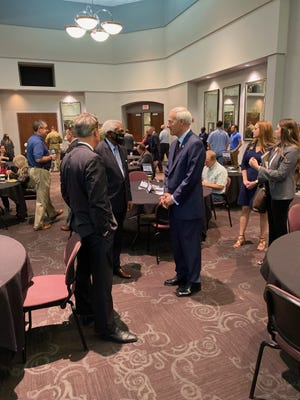 Gov. Asa Hutchinson meets with Fort Smith Mayor George McGill and Tim Allen, president of the Fort Smith Regional Chamber of Commerce, during his COVID Community Conversation.