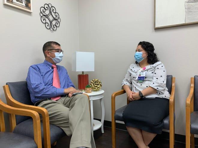 Dr. Wilson Cruz and Rosa Hernandez, clinic coordinator, chat in the reception area of La Cliníca Del Pueblo.