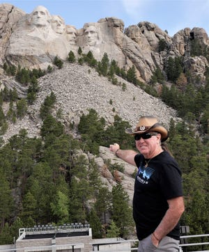 John points out the four presidents of Mount Rushmore.