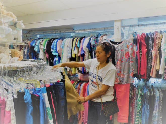 Eager customer Grace Rosales shops inside the Baylor Auxiliary Thrift Store on Thursday after the store reopened for the first time since the start of the COVID-19 pandemic.