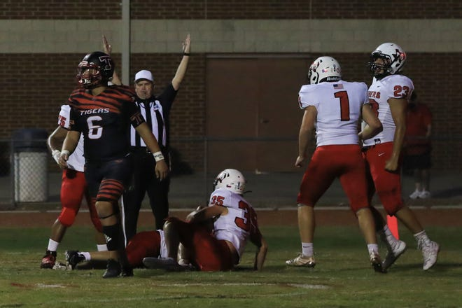 Maypearl players celebrate as linebacker Garrett Baggett (35) recovers a fumble in the end zone for a touchdown during a September non-district game at Trenton.