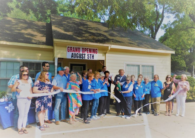 A ribbon cutting celebration was held Thursday in front of the Baylor Auxiliary Thrift Store for its grand re-opening.