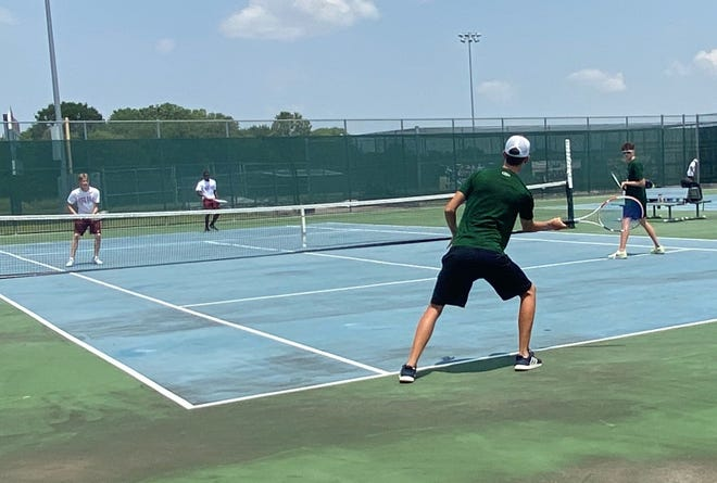 Waxahachie boys' doubles tennis players take on Red Oak on Thursday during the 2021 season-opener for both teams at Red Oak High School. The Indians won, 22-1.