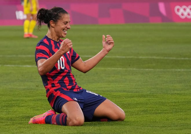 United States forward Carli Lloyd (10) celebrates after scoring a goal against Team Australia goalkeeper Teagan Micah (18) in the second half during the bronze medal match during the Tokyo 2020 Olympic Summer Games at Ibaraki Kashima Stadium.