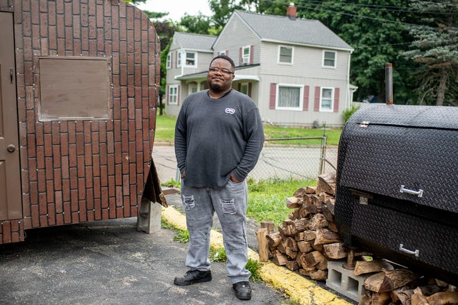 Walter Brown stands for a photograph near the Mr. Ribs  BBQ trailer and smoker on Friday, Aug. 6, 2021 at 2497 SW Capital Ave in Battle Creek, Michigan.