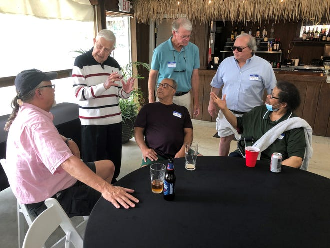 Pat Mancuso chats with several former players before a luncheon honoring him and several other former Princeton coaches at the Century Inn in Woodlawn.