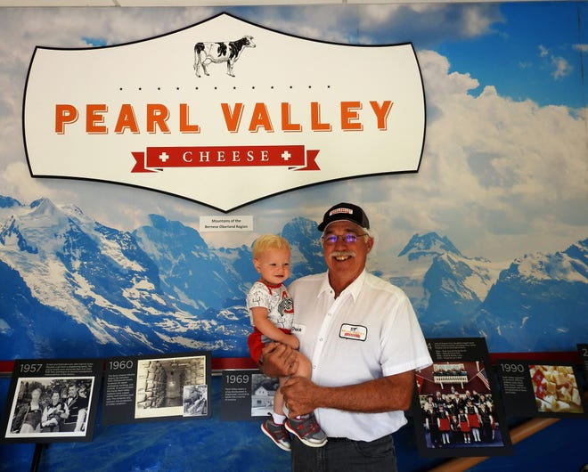 Chuck Ellis holds is 1-year-old grandson, William Ellis, in the front hall of the Pearl Valley Cheese business office. Chuck and his wife Sally are the third generation to own the company in Fresno, with their sons and nephews poised to take over in a few years.
