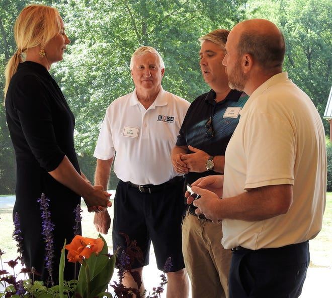 Lydia Mihalik, director of the Ohio Department of Development, speaks with Jim Schoch, dxecutive director of Eastern Ohio Development Alliance, Coshocton Safety Services Director Max Crown and Mayor Mark Mills at a recent EODA meeting at Clary Gardens.