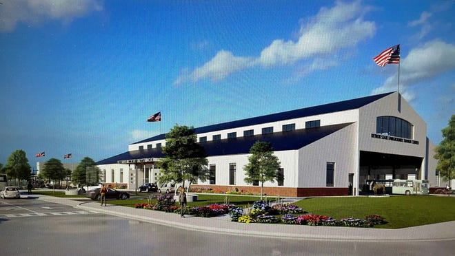 A conceptual image shows the Dairy Cattle Building at the old Michigan State Fairgrounds repurposed as the heart of the proposed transit center near a future Amazon Distribution site in Detroit.