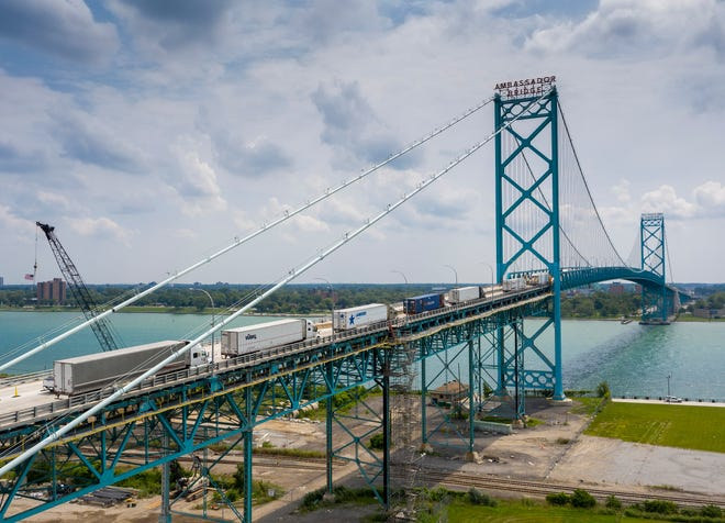 Traffic is backed up on the Ambassador Bridge in Detroit, Friday, August 6, 2021.