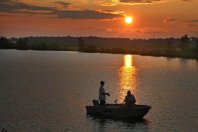 A pair of anglers try their luck as the sun sets at Silver Rock Quarry in Gibsonburg.
